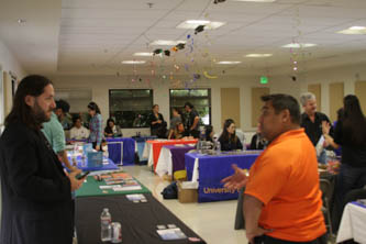Steve talks to attendees at an Autism resource fair