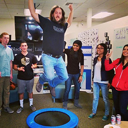 Steve jumps on a trampoline after speaking to enterpreneurship students at UC Irvine